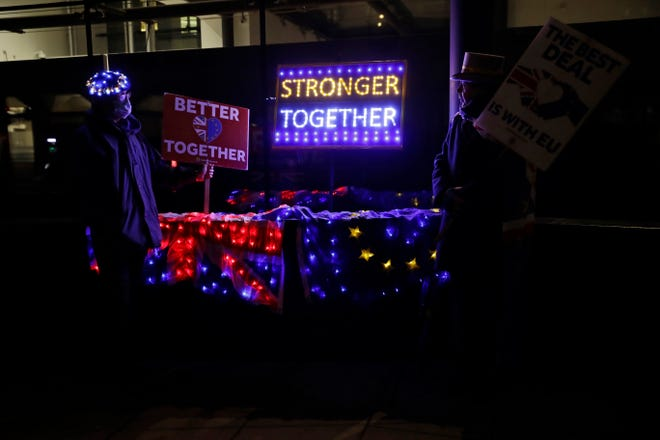 Pro-European Union membership supporters protest outside Brexit trade negotiations between Britain and the EU Friday outside the Conference Centre in London.