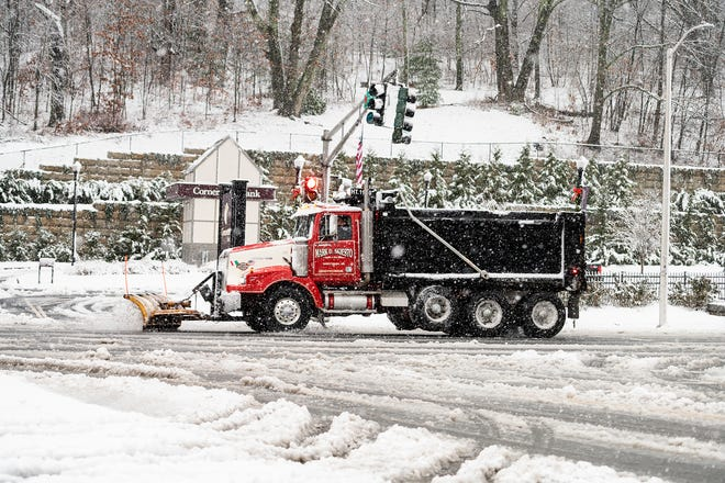 WORCESTER - A plow clears snow on Park Avenue during the storm on Saturday.