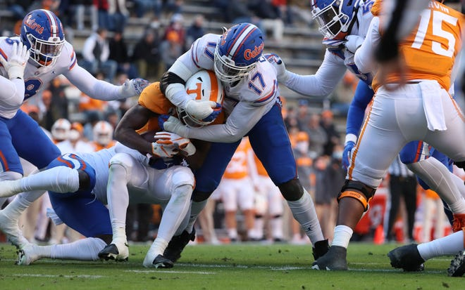 Florida defensive lineman Zachary Carter (17) makes a tackle during the Gators' game against the Tennessee Volunteers on Saturday, December 5, 2020 at Neyland Stadium in Knoxville,