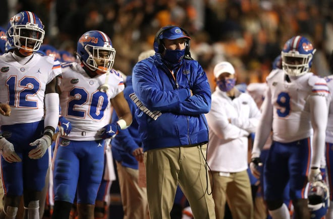 Florida coach Dan Mullen watches hits Gators face Tennessee on Saturday at Neyland Stadium in Knoxville, Tenn.