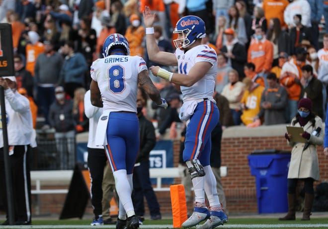 Florida quarterback Kyle Trask (11) celebrates with receiver Trevon Grimes after Grimes scored a touchdown Saturday against Tennessee at Neyland Stadium in Knoxville, Tenn.