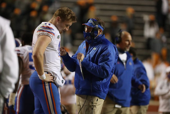Florida head coach Dan Mullen talks with quarterback Kyle Trask (11) during the Gators' game against the Tennessee Volunteers on Saturday, December 5, 2020 at Neyland Stadium in Knoxville, Tenn.