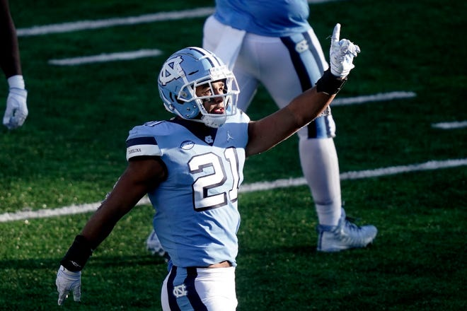 Chazz Surratt celebrates a quarterback sack against Wake Forest in the fourth quarter that helped complete North Carolina's comeback victory last month.