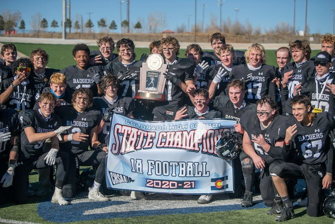The Limon High School football team pose with the Colorado Class 1A state football championship trophy after defeating Strasburg at the Neta and Eddie Derose ThunderBowl on December 5, 2020.
