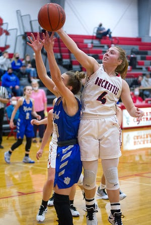 Buckeye Central's Claudia Pifher snags a rebound over Wynford's Lyndie Williams.