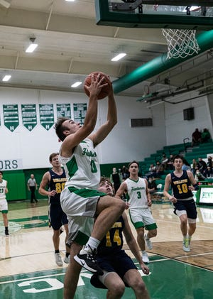 Huntington senior Gavin Free takes it to the rim Friday night against Wellston at Huntington High School. Free scored seven out of Huntington's 44 total points.