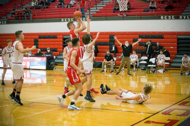 Alec Laaper takes the charge against Sheridan's Nate Johnson during first half varsity boys basketball on Friday night in Coshocton.