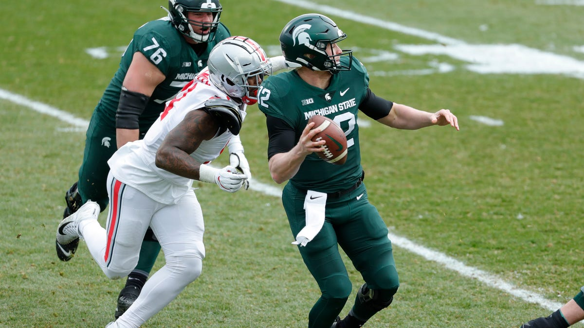 Michigan State football lousy, dominated by short-handed Ohio...