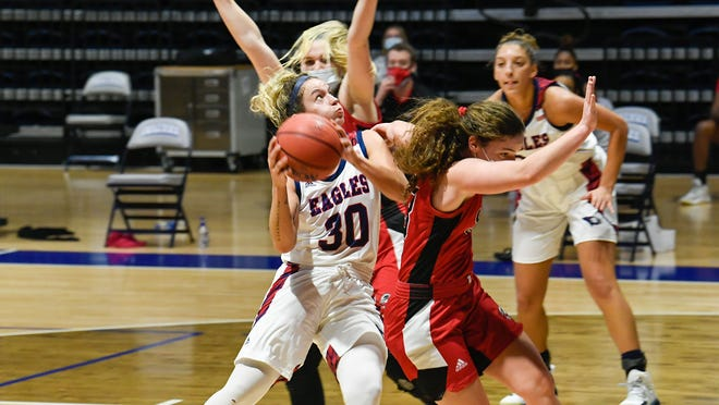 Emma DeHart fights through the Lewis defense for a tough basket.
