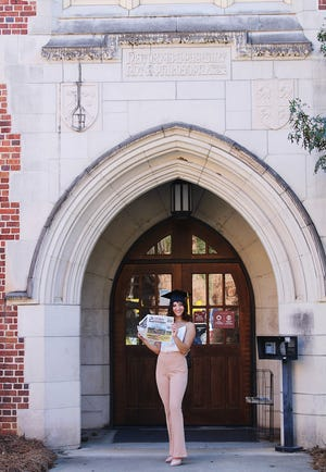 Graduating senior and Arts and Culture writer Madeline Brik holds up the newspaper and bids her goodbyes to her fellow staff writers and friends as she finishes her undergraduate career at Florida State University.