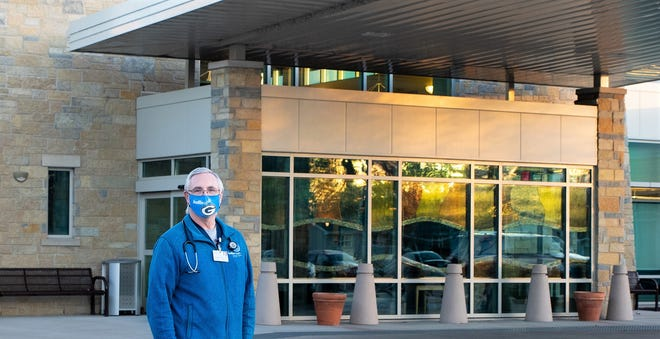 Dr. Charles Heyka stands outside Bellin Health Oconto Hospital, where he's cared for patients who recovered from COVID-19 but still need rehabilitation and treatment for underlying conditions before they can return home.