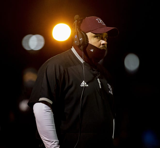Holy Cross head coach Eric Dick looked on as his team faced off against the Newport Central Thoroughbreds in the Class A Regional title game on Friday, Dec. 4, 2020.