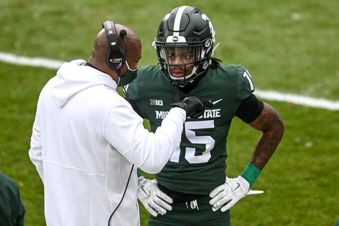 Michigan State's head coach Mel Tucker, left, talks with Angelo Grose during the first quarter in the game against Ohio State on Saturday, Dec. 5, 2020, at Spartan Stadium in East Lansing.