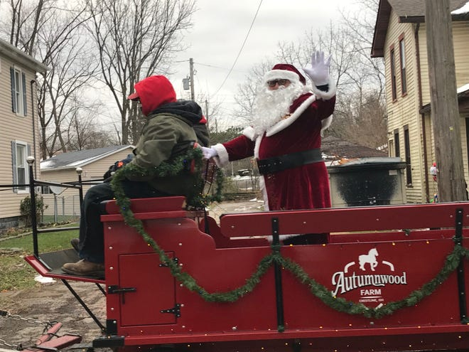 Santa and two Belgians named Chuck and Ben stole the show during the Crestline Santa Parade as the team of two horses pulling the shiny red wagon announced their arrival with the sounds of hooves clomping in unison and jingle bells Saturday.