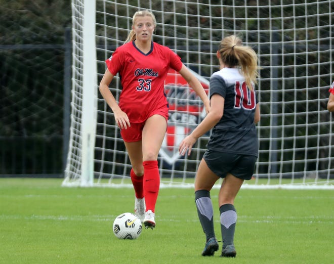 Ole Miss midfielder Molly Martin (left) looks upfield in a Southeastern Conference match against Arkansas on Oct. 25, 2020. The former ECS standout registered three assists this fall for the Rebels.