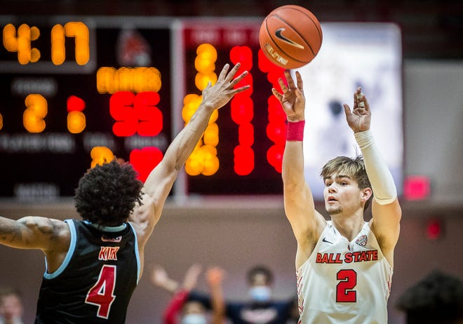 Ball State's Luke Bumbalough shoots past UIC's defense during their game at Worthen Arena Saturday, Dec. 5, 2020.