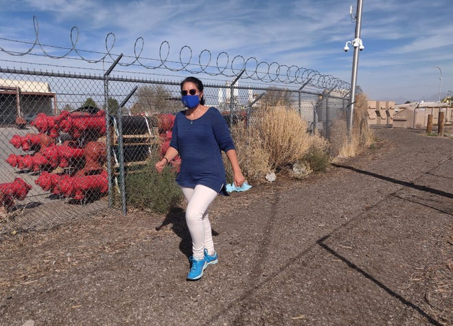 Las Cruces Utilities Senior Engineer Rocío Nasir takes a quick walk around the new LCU walking path that allows for a lap around the property at 680 N. Motel Boulevard. LCU used composted mulch, pavement millings, and unused space for the health benefit of its associates.