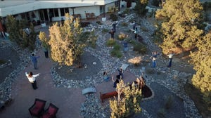 """Members of the San Juan College Choir perform in the back yard of Allen and Karon Lyon in Farmington in October while footage is shot by a drone for the program """"How Can I Keep from Singing."""""""