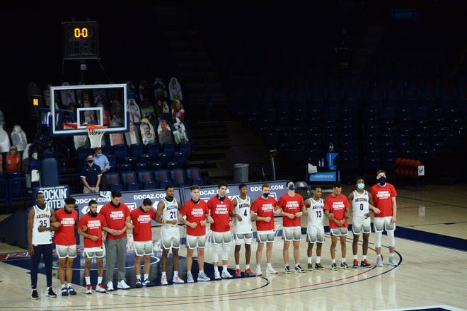 Dec 5, 2020; Tucson, Arizona, USA; A general view of the national anthem as Arizona Wildcats look on prior to the first half against the Eastern Washington Eagles at McKale Center. Mandatory Credit: Joe Camporeale-USA TODAY Sports