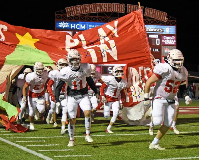 The Christoval Cougars charge onto the field before their Class 2A Division II state quarterfinal football game against Falls City on Friday, Dec. 4, 2020, at Battlin' Billie Stadium in Fredericksburg.