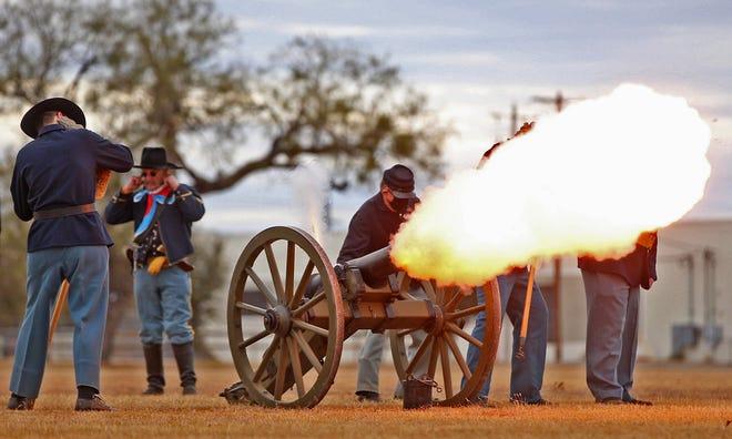 Reenactors fire a ceremonial artillery shot at Fort Concho on Saturday, Dec. 5, 2020.