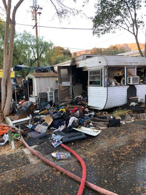 This was the aftermath of a fire inside a mobile home in Meiners Oaks which sent two people to the hospital on Friday.
