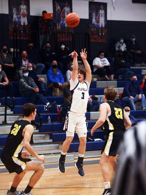 Jason Wells shoots a 3 during the first half of Morgan's 52-44 win against visiting Tri-Valley on Friday night in McConnelsville.