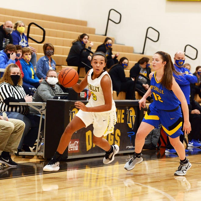 Lexi Howe drives up the court as Averee Vaughn guards closely in Tri-Valley's 61-47 win against visiting Maysville on Saturday in Dresden. Howe scored a game-high 20 points.