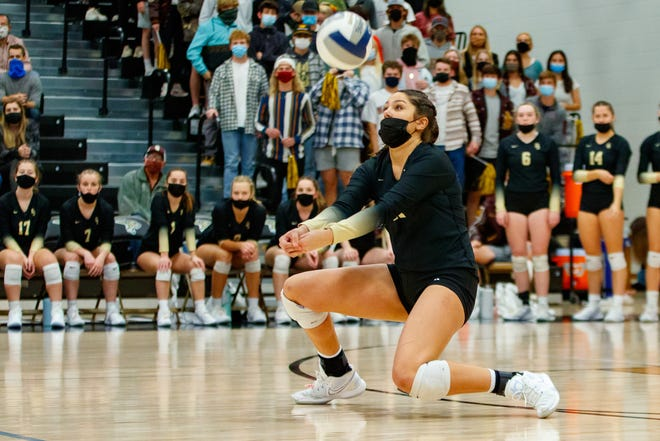 Dripping Springs outside hitter Mackenzie Plante digs the ball against Canyon during the Tigers' Class 4A region final win at Johnson High School Saturday. Plante led the way for the Tigers with 16 kills and 17 digs.