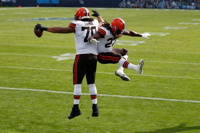 Browns offensive tackle Kendall Lamm (70) celebrates with running back Kareem Hunt (27) after Lamm caught a touchdown pass against the Tennessee Titans in the first half of Sunday's game. [Wade Payne/Associated Press]