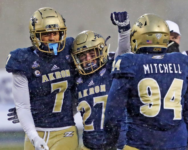 Akron Zips linebacker Bubba Arslanian (27) celebrates with teammates after sacking Bowling Green Falcons quarterback Matt McDonald (3) during the second half of an NCAA football game at InfoCision Stadium, Saturday, Dec. 5, 2020, in Akron, Ohio. [Jeff Lange/Beacon Journal]