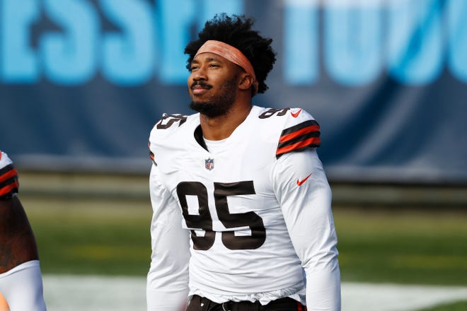 Browns defensive end Myles Garrett (95) prepares for Sunday's game against the Tennessee Titans. Returning after missing two games on the reserve-Covid-19 list, Garrett had a key sack in the fourth quarter. [Wade Payne/Associated Press]