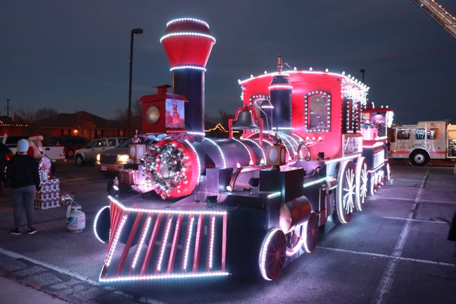 The train from the play Texas highlights the end of the Canyon Reverse Christmas Light Parade Saturday evening on the Canyon High School campus.[Neil Starkey / For the Amarillo Globe-News]