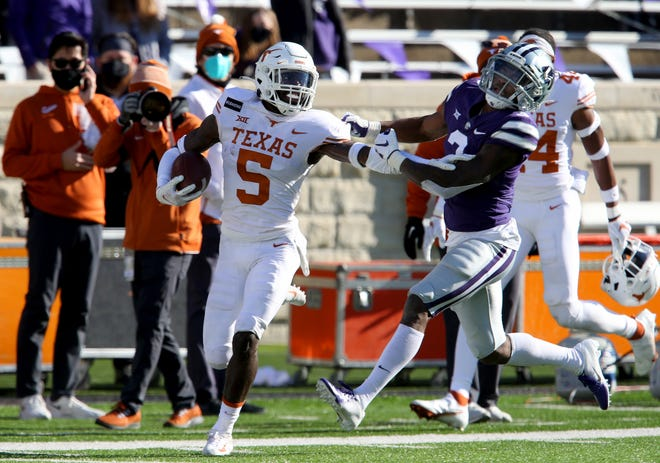 Texas running back Bijan Robinson was named the Big 12's newcomer of the week Monday.