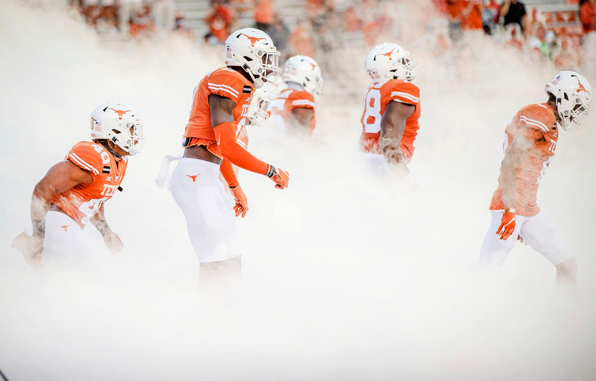 Texas Longhorns pause football team activities due to positive COVID-19 tests