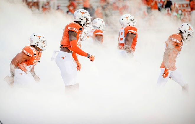 Texas players take the field for their season-opening 59-3 win over UTEP on Sept. 12. Eight games later, the Longhorns are 6-3 and facing Colorado in the Alamo Bowl.