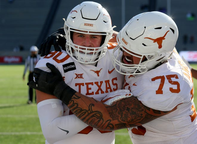 Texas tight end Cade Brewer, left, is congratulated by offensive lineman Junior Angilau after Brewer scored a touchdown against Kansas State last December. The senior tight end from Lake Travis decided to return for one final season to see what tight ends can do in Steve Sarkisian's offense.