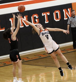 Marlington's Chelsea Evanich, right, tries to block a pass to Dalton's Ella Lunsford during their game at Marlington High School on Saturday, December 5, 2020.