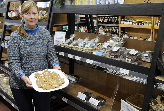 Betsy Anderson poses with a platter of her gingerbread cookies at Local Roots in Wooster on Thursday, Dec. 3, 2020. TOM E. PUSKAR/TIMES-GAZETTE.COM