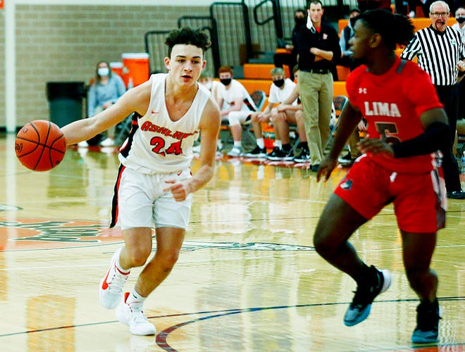 Ashland High's Grayson Steury (24) drives with the ball as Lima Senior's Cam Miles (5) defends during Ashland's 71-53 loss on Saturday night at Arrow Arena.