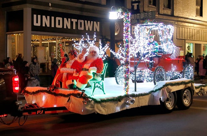 Sticks-n-Stones Landscaping pulled the float with Santa and Mrs. Claus in the annual Ashland Christmas parade on Saturday night.