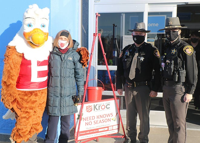"""From left, Eddie Eagle, the Ashland County Sheriff's Office mascot; Salvation Army Major Annalise Francis; Lt. Don Sims of the Sheriff's Office; and DARE Officer Angie Hamilton of the Sheriff's Office on Friday when Sheriff's Office members served as """"special bell ringers"""" for the Salvation Army's Red Kettle Campaign."""