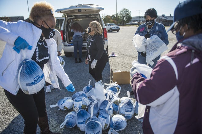 Volunteers bag turkeys to be distributed for the annual James Brown Turkey Giveaway on Nov. 20, 2020.