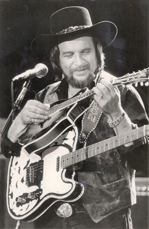 Waylon Jennings performs in Nashville, Tenn., in this May 1984 photo. In December 1979, Jennings was the first to perform at Augusta's Civic Center. The country music legend died in 2002 at age 64. [Mark Humphrey/File/Associated Press]