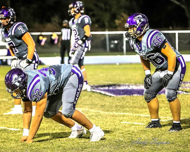 The Rosepine duo of Haydn Runge (32) and David Schlittenhard (66) prepare to shut down an opposing offense during recent action. The Eagles fell to third-seeded Loreauville on Friday, 41-18