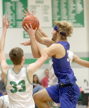 Boonville senior Charlie Bronakowski (32) drives the middle of the lane in the third quarter Friday night against Blair Oaks in the championship game in the Tri-County Conference Tournament in Wardsville.