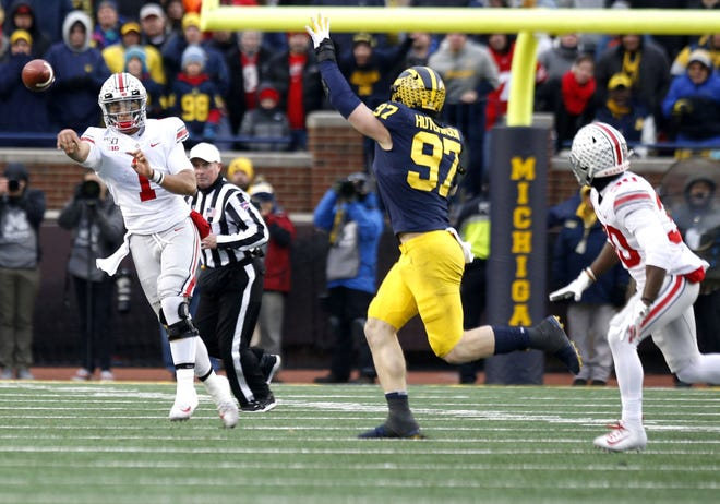 Ohio State Buckeyes quarterback Justin Fields (1) attempts a pass to wide receiver Demario McCall (30) during the fourth quarter of a NCAA Division I college football game between the Michigan Wolverines and the Ohio State Buckeyes on Saturday, November 30, 2019 at Michigan Stadium in Ann Arbor Michigan [Joshua A. Bickel/Dispatch]