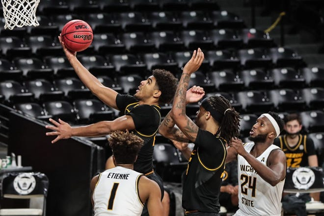 Missouri guard Mark Smith (13) drives toward the hoop during a game against Wichita State on Sunday afternoon at Charles Koch Arena in Wichita, Kan.