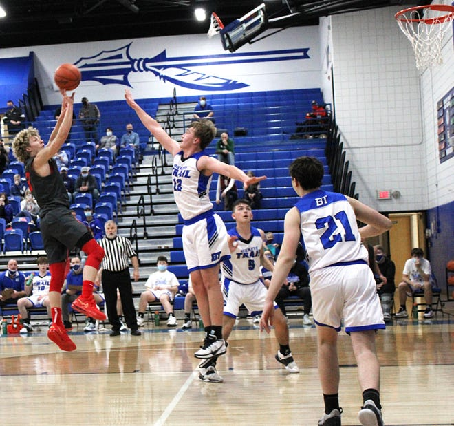 Caldwell's Bede Lori (3) shoots the ball as Buckeye Trail's Garrett (12) attempts to block the shot during the Ohio Roundball Classic at Buckeye Trail High school on Saturday evening.