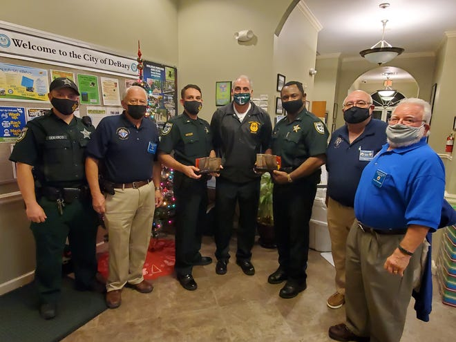 Members of the Knights of Columbus Council 13571 gave $500 worth of gift cards to Volusia County sheriff's deputies during the DeBary City Council meeting Wednesday, Dec. 2, 2020. The knights donated $250, which was matched by the city, to give to deputies to assist people they meet during their shifts who are in need of help.